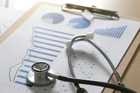 Charts and stethoscope representing measuring a government agency. Credit: https://www.istockphoto.com/portfolio/juststock