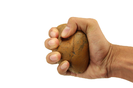 A hand holding a very tangible rock. Credit: https://www.istockphoto.com/au/portfolio/t-gomo