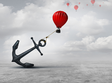 A hot air balloon trying to pull a large anchor. Credit: wildpixel