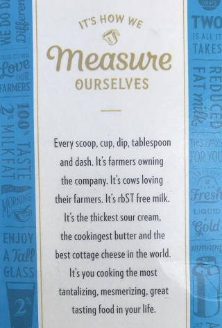 Photo of a carton of milk stating how they measure