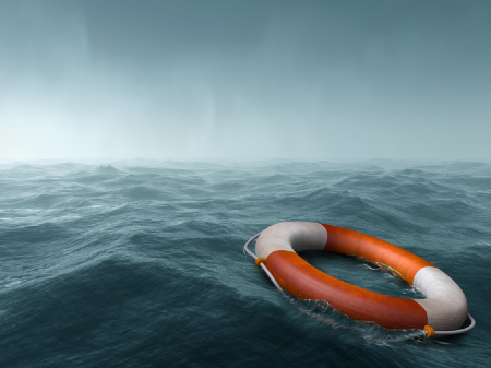 A lifebuoy floating in rough seas. Credit: https://www.istockphoto.com/au/portfolio/paulfleet