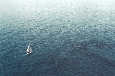 Lone sailboat on the ocean representing trying to navigate without a map. KPIs. Credit: https://www.istockphoto.com/portfolio/francescoch