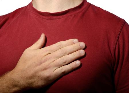 A man holding hand over heart. Credit: https://www.istockphoto.com/au/portfolio/roberthyrons