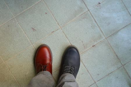 Mismatched shoes representing checking if your metrics match your rhetoric. Credit: https://www.istockphoto.com/portfolio/evergreentree