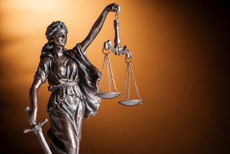 Statue of Justice holding scales. Credit https://www.istockphoto.com/au/portfolio/serggn