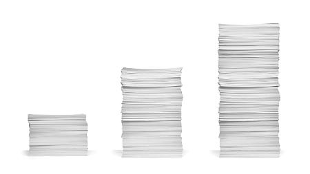 Increasingly taller stacks of paper. Credit: https://www.istockphoto.com/portfolio/paperkites