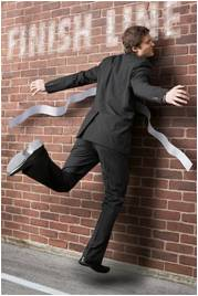 businessman running into brick wall/finish line