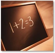 equation on a blackboard: 1 + 2 = 3