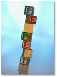 "tower of building blocks spelling out ""perfect"""